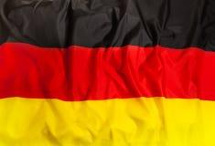 Εθνική σημαία της Γερμανίας με το κυματίζοντας ύφασμα Στοκ Φωτογραφία