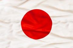 Εθνική σημαία της Ιαπωνίας με το κυματίζοντας ύφασμα Στοκ φωτογραφίες με δικαίωμα ελεύθερης χρήσης