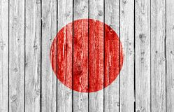 Εθνική σημαία της Ιαπωνίας στο παλαιό ξύλινο υπόβαθρο στοκ εικόνες με δικαίωμα ελεύθερης χρήσης