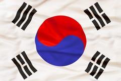 Εθνική σημαία της Νότιας Κορέας με το κυματίζοντας ύφασμα Στοκ Φωτογραφία