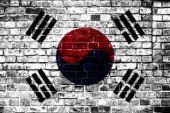 Εθνική σημαία της Νότιας Κορέας σε ένα υπόβαθρο τούβλου στοκ φωτογραφίες με δικαίωμα ελεύθερης χρήσης