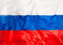 Εθνική σημαία της Ρωσίας με το κυματίζοντας ύφασμα Στοκ εικόνα με δικαίωμα ελεύθερης χρήσης