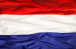 Εθνική σημαία Netherland με το κυματίζοντας ύφασμα Στοκ φωτογραφίες με δικαίωμα ελεύθερης χρήσης
