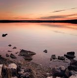 ειδυλλιακός πέρα από το ύδωρ ηλιοβασιλέματος θάλασσας στοκ φωτογραφία