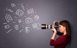 Εικονίδια φωτογραφίας πυροβολισμού κοριτσιών φωτογράφων Στοκ φωτογραφία με δικαίωμα ελεύθερης χρήσης