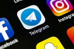 Εικονίδιο εφαρμογής τηλεγραφημάτων στο iPhone Χ της Apple κινηματογράφηση σε πρώτο πλάνο οθόνης App τηλεγραφημάτων εικονίδιο Το τ Στοκ εικόνα με δικαίωμα ελεύθερης χρήσης