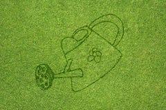 Εικονίδιο κάδων στην πράσινη χλόη στοκ εικόνα
