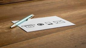 Εικονίδια μανδρών και επαφών που τυπώνονται σε μια άσπρη κάρτα Στοκ εικόνα με δικαίωμα ελεύθερης χρήσης