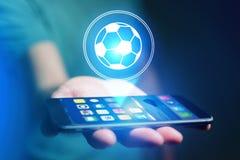 Εικονίδιο σφαιρών ποδοσφαίρου πέρα από τη συσκευή - αθλητισμός και έννοια τεχνολογίας Στοκ Εικόνες
