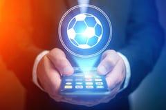 Εικονίδιο σφαιρών ποδοσφαίρου πέρα από τη συσκευή - αθλητισμός και έννοια τεχνολογίας Στοκ φωτογραφία με δικαίωμα ελεύθερης χρήσης