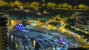 Εικονική παράσταση πόλης νύχτα του Μόντε Κάρλο, Μονακό timelapse με τα γιοτ και την κυκλοφορία στο ανάχωμα απόθεμα βίντεο