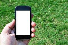Εικόνα προτύπων του χεριού που κρατά το μαύρο κινητό τηλέφωνο Στοκ Εικόνες