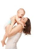 Εικόνα της ευτυχούς μητέρας το λατρευτό μωρό που απομονώνεται με Στοκ φωτογραφίες με δικαίωμα ελεύθερης χρήσης