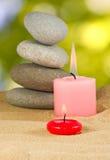 Εικόνα των κεριών και των πετρών στενό σε επάνω άμμου Στοκ Εικόνα
