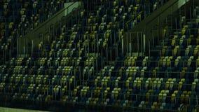 Εικόνα των μπλε και κίτρινων καθισμάτων στις εξέδρες επισήμων σταδίων με τα κιγκλιδώματα διανυσματική απεικόνιση
