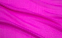 Εικόνα υποβάθρου ενός ρόδινου ελαφριού υφάσματος που διπλώνεται Στοκ Εικόνα