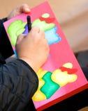 εικόνα s πινέλων χεριών καλ&lamb Στοκ Φωτογραφία