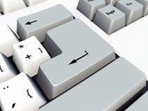 Εισάγετε το κλειδί σε ένα πληκτρολόγιο υπολογιστών Στοκ Φωτογραφίες