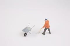 Ειδώλιο του εργάτη οικοδομών στην κατασκευή Στοκ Εικόνες