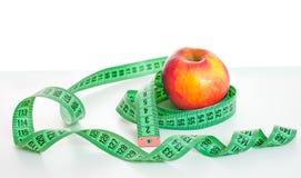 Εκατοστόμετρο και μήλο Στοκ Εικόνα