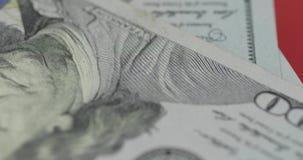 Εκατό αμερικανική περιστροφή λογαριασμών δολαρίων E Υπόβαθρο με τους λογαριασμούς δολαρίων απόθεμα βίντεο