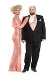 Εκκεντρικό παχύ άτομο σε ένα σμόκιν και όμορφη κυρία ένα βράδυ Δ Στοκ εικόνα με δικαίωμα ελεύθερης χρήσης
