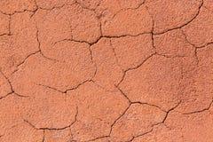 Εκλεκτής ποιότητας κοκκινωπό ή πορτοκαλί ραγισμένο υπόβαθρο σύστασης βράχου αφηρημένη σύσταση πετρών Στοκ Εικόνες