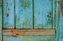 Εκλεκτής ποιότητας ξύλινο υπόβαθρο με το χρώμα αποφλοίωσης Στοκ Φωτογραφίες