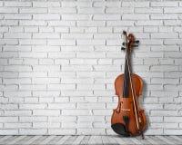 Εκλεκτής ποιότητας παλαιό βιολί κοντά στο υπόβαθρο τουβλότοιχος στοκ φωτογραφία με δικαίωμα ελεύθερης χρήσης