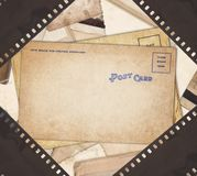 Εκλεκτής ποιότητας υπόβαθρο με την αναδρομική κάρτα και την παλαιά λουρίδα ταινιών Στοκ Εικόνες