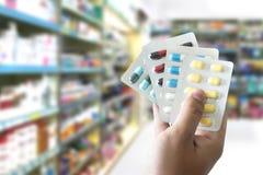 εκμετάλλευση υγειονομικής περίθαλψης στα χάπια ελέγχου των γεννήσεων πακέτων φαρμακείων pharm στοκ εικόνα με δικαίωμα ελεύθερης χρήσης