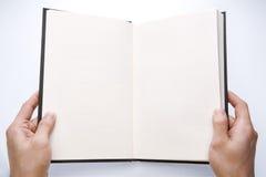 εκμετάλλευση χεριών βιβλίων Στοκ Εικόνες