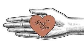 Εκμετάλλευση χεριών γυναικών ` s στην παλάμη μια κόκκινη καρδιά εγγράφου με την αγάπη Υ Ι απεικόνιση αποθεμάτων