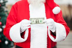 Εκμετάλλευση Άγιου Βασίλη σημείωση ενός δολαρίου Στοκ φωτογραφία με δικαίωμα ελεύθερης χρήσης