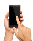 Εκμετάλλευση και αφή χεριών σε κόκκινο Smartphone Στοκ Φωτογραφία