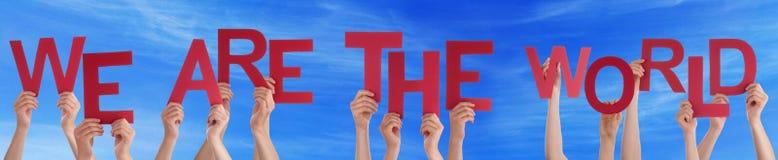 Εκμετάλλευση το κόκκινο Word χεριών είμαστε ο παγκόσμιος μπλε ουρανός Στοκ εικόνα με δικαίωμα ελεύθερης χρήσης