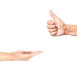 Εκμετάλλευση χεριών ατόμων με τον αντίχειρα επάνω όπως Στοκ Εικόνες