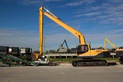 Εκσκαφέας στο εργοτάξιο οικοδομής Στοκ εικόνα με δικαίωμα ελεύθερης χρήσης