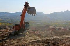 Εκσκαφείς στην εργασία στο εργοτάξιο οικοδομής Στοκ φωτογραφία με δικαίωμα ελεύθερης χρήσης