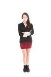 Εκτελεστικό νέο κορίτσι που φορούν την κόκκινη φούστα και ο Μαύρος Στοκ εικόνες με δικαίωμα ελεύθερης χρήσης