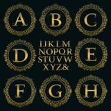 Εκλεκτής ποιότητας εξάρτηση μονογραμμάτων Χρυσές επιστολές και floral στρογγυλά πλαίσια Στοκ Φωτογραφία