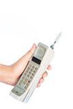 Εκλεκτής ποιότητας κινητό τηλέφωνο εκμετάλλευσης χεριών ατόμων που απομονώνεται Στοκ Φωτογραφίες