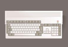 Εκλεκτής ποιότητας υπολογιστής δεκαεξάμπιτος στο γκρίζο υπόβαθρο Στοκ Εικόνες