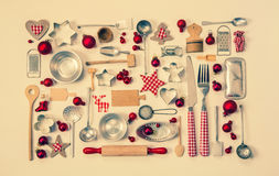 Εκλεκτής ποιότητας υπόβαθρο Χριστουγέννων με μια συλλογή πολλοί κόκκινος έλεγχος Στοκ Εικόνες
