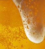 ελαφριά σύσταση αφρού μπύρ&alpha Στοκ Φωτογραφία