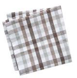 Ελεγμένη καφετιά διπλωμένη πετσέτα που απομονώνεται Στοκ Εικόνα