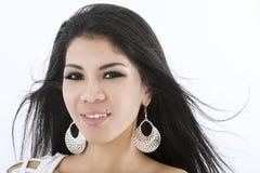 Ελκυστική ασιατική γυναίκα με το φυσώντας τρίχωμα Στοκ Εικόνες