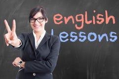 Ελκυστικός νέος δάσκαλος που παίρνει το αγγλικό μάθημά της Στοκ Εικόνα