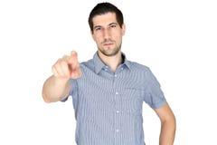 Ελκυστικός περιστασιακός νεαρός άνδρας που δείχνει το δάχτυλό του Στοκ Εικόνα