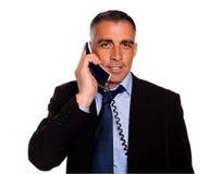 ελκυστικό πανέμορφο τηλέφωνο επιχειρηματιών Στοκ Εικόνες